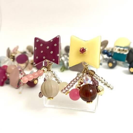 ピンク系&イエローのリボン型耳飾り
